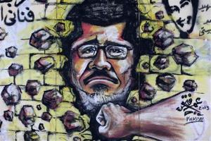 Graffiti depicting Egypt's Islamist President Mohammed Morsi covers an outer wall of the presidential palace in Cairo, Egypt, Monday, July 1, 2013. Hundreds of thousands thronged the streets of Cairo and cities around the country Sunday and marched on the presidential palace, filling a broad avenue for blocks, in an...