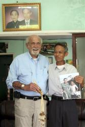 Dr. Sam Axelrad, left, displays the bones of an arm belonging to former North Vietnamese soldier Nguyen Quang Hung, right, at Hung's house in the town of An Khe, Gia Lai province, Vietnam on July 1, 2013.