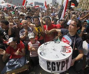 Egyptian protesters shout slogans and wave national flags during a demonstration against Egypt's Islamist President Mohammed Morsi in Tahrir  Square in Cairo, July 1, 2013.