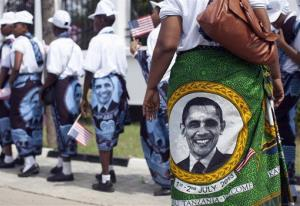 Young girls and women wear khangas with the image of resident Barack Obama as they line up to enter the State House  in Dar es Salaam, Tanzania, yesterday.