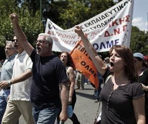 State school teacher shout slogans outside the ministry of Administrative Reform during a protest against the austerity measures in central Athens, July 2, 2013.