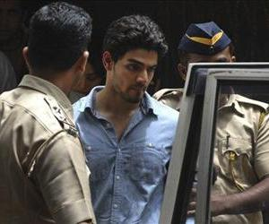 Suraj Pancholi is escorted by police as he leaves after appearing before a court in Mumbai, India, Tuesday, June 11, 2013.