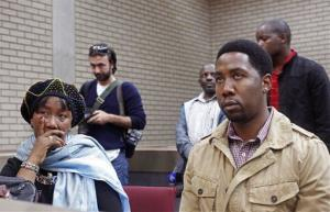 Makaziwe Mandela, daughter of Nelson Mandela, left, and grandson Ndaba Mandela sit in court in Mthatha, South Africa, Tuesday.