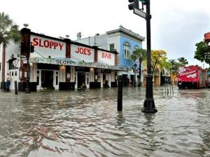 This May 2, 2013, file photo shows flooding on Duval Street in Key West, Fla., after roughly five inches of rainfall.