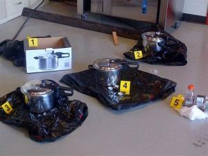 This evidence photo released by the Royal Canadian Mounted Police shows three pressure cookers linked to the suspects.