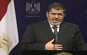 This image made from video broadcast on Egyptian State Television shows President Mohammed Morsi addressing the nation.