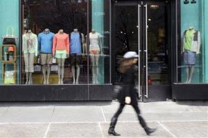 A woman walks past a Lululemon Athletica store in New York.