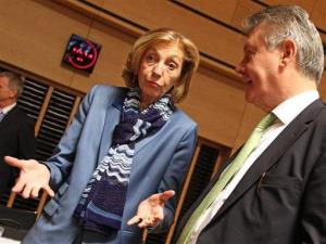 French Foreign Trade Minister Nicole Bricq talks with European Commissioner for Trade Karel De Gucht.