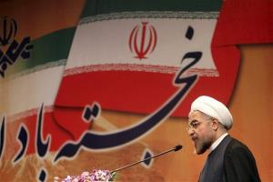 Iranian President-elect Hasan Rouhani speaks in a conference in Tehran, Iran.