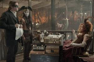 Armie Hammer, Johnny Depp and Helena Bonham Carter act in a scene during the filming of the movie The Lone Ranger.