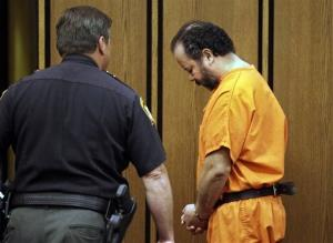 Ariel Castro is led back to jail after a hearing in Cuyahoga County Common Pleas Court in Cleveland, Wednesday, July 3, 2013.