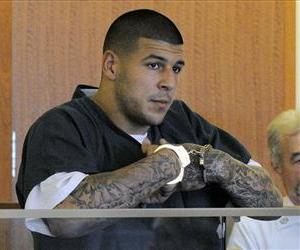 Former New England Patriots football tight end Aaron Hernandez stands during a bail hearing in Fall River Superior Court Thursday, June 27, 2013 in Fall River, Mass.