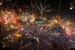 Celebratory fireworks light the sky in Cairo's Tahrir Square.