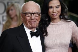 In this Sunday, Jan. 15, 2012, file photo, Rupert and Wendi Murdoch arrive at the 69th Annual Golden Globe Awards in Los Angeles.
