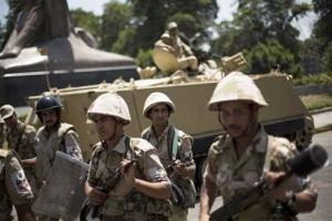 Egyptian soldiers deploy near Cairo University, where Muslim Brotherhood supporters gathered to support ousted president Mohamed Morsi in Cairo, Thursday, July 4, 2013.