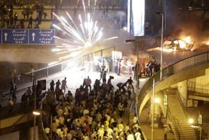 Supporters and opponents of Mohamed Morsi clash in Cairo Friday.