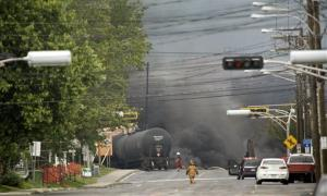 Smoke rises from railway cars that were carrying crude oil through Lac Megantic, Quebec.