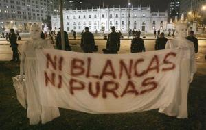 Pro-choice demonstrators hold a banner that reads in Spanish 'Neither white, neither pure' during a protest against a court decision halting free morning-after pills in Santiago.