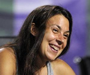 Marion Bartoli speaks at a news conference after winning the Women's singles final match against Sabine Lisicki at Wimbledon, London, Saturday, July 6, 2013.