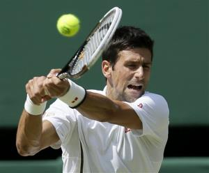 Novak Djokovic of Serbia returns to Andy Murray of Britain during the Men's singles final match at the All England Lawn Tennis Championships in Wimbledon, London, Sunday, July 7, 2013.