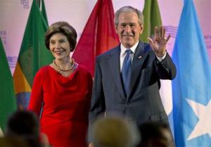 George W. Bush and Laura Bush arrive at the African First Ladies Summit, hosted by the George W. Bush Institute, Tuesday, July 2, 2013, in Tanzania.
