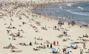People gather on Bondi Beach in Sydney, Australia.