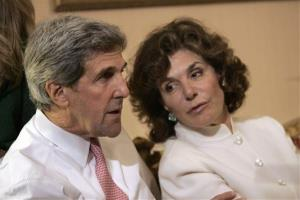 In this Tuesday, Nov. 4, 2008 photo, John Kerry talks with his wife Teresa Heinz Kerry while watching election results at a hotel in Boston.