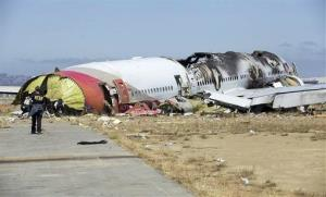 This image released by the National Transportation Safety Board  shows NTSB workers near the Boeing 777 Asiana Airlines Flight 214 aircraft.