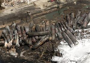 The remains of tanker cars lie burnt out in the downtown core of  Lac Megantic, Quebec.