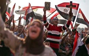 Opponents of Egypt's ousted President Mohammed Morsi rally in Tahrir Square in Cairo, Egypt, Sunday, July 7, 2013.