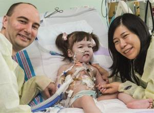 Darryl Warren and Lee Young-mi visit daughter Hannah in a post-op room at Children's Hospital of Illinois in Peoria after she received a new windpipe in a landmark transplant operation April 9, 2013.