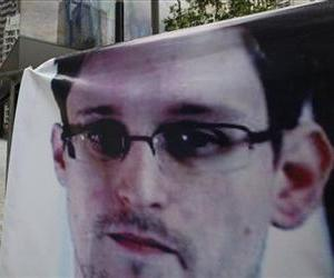 A banner supporting Edward Snowden is displayed at Central, Hong Kong's business district, June 20, 2013.