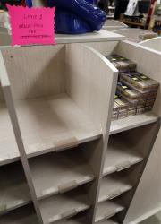 Only a few boxes of .22-caliber short ammunition remain on the shelves near a posted sign restricting the amount of ammunition people can buy at Duke's Sport Shop in New Castle, Pennsylvania.