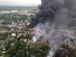 This aerial photo shows a fire in the town of Lac-Megantic as seen from a Sûreté du Québec helicopter Saturday, July 6, 2013 following a train derailment that sparked several explosions in Lac Megantic, Quebec.