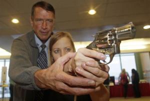 Cori Sorensen, a fourth grade teacher from Highland Elementary School in Highland, Utah, receives firearms training.