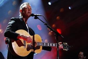 In this June 7, 2013 file photo, Randy Travis performs on day 2 of the 2013 CMA Music festival at the LP Field in Nashville, Tenn.
