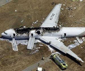 In this Saturday, July 6, 2013 aerial photo, the wreckage of Asiana Flight 214 lies on the ground after it crashed at the San Francisco International Airport, in San Francisco.