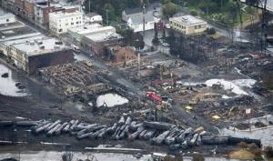 In this aerial photo, workers comb through the debris in Lac-Megantic, Quebec, Canada.