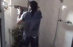 A Syrian rebel firing his weapon in Damascus.