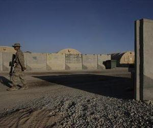 A U.S. Marine walks past a blast barrier inside Camp Leatherneck, in Helmand province, southern Afghanistan, Friday, Oct. 9, 2009.