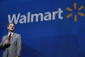 President and CEO of Walmart International Doug McMillan addresses the crowd during the Walmart shareholders meeting in Fayetteville, Ark., Friday, June 7, 2013.