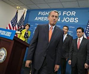 House Speaker John Boehner of Ohio, and GOP leaders, finish a news conference on Capitol Hill, July 9, 2013, following a Republican strategy session.