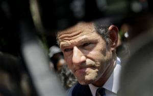 Former New York governor Eliot Spitzer is surrounded by media as he tries to collect signatures for his run for New York City comptroller in New York, Monday, July 8, 2013.