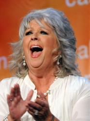 In this Oct. 26, 2009 file photo, Paula Deen applauds at the Women's Conference 2009 Night in Long Beach, Calif.