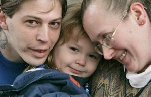 In this Tuesday, Dec. 16, 2008 file photo, Heath Campbell, left, with his wife, Deborah, and son Adolf Hitler Campbell, 3, pose in Easton, Pa.