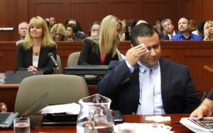 George Zimmerman wipes his face after arriving in the courtroom during his trial in Sanford, Fla., Friday, July 12, 2013.