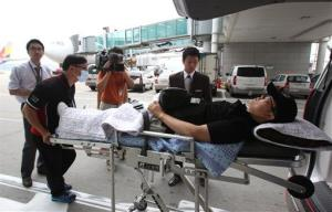 An injured South Korean passenger, who was aboard Asiana Airlines Flight 214 when it crashed.