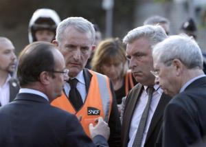 French president Francois Hollande, left, at the site of a train accident in the railway station of Bretigny-sur-Orge.