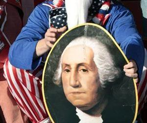 A United States' fan, holding up an image of the first President of the United States George Washington.