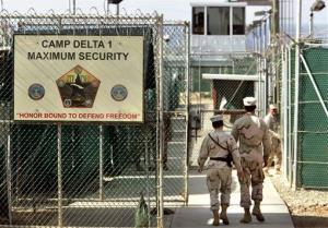 US military guards walk within the Camp Delta military-run prison at the Guantanamo Bay US Naval Base, Cuba.